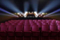 Empty theater auditorium or cinema with red seats. Empty theater auditorium or cinema with red seats and lighting behind stock image