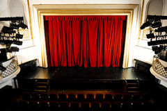 Empty Theater Stage. With lights on and curtain brought down stock image