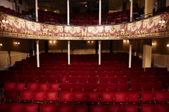Empty Theatre. View of an empty theatre with red seats and balcony Royalty Free Stock Photography