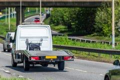 Empty tilt trailer truck on uk motorway in fast motion.  royalty free stock image