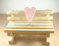 Empty timber chair with pink heart shape Royalty Free Stock Photo