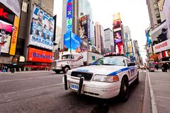 Empty Times Square in morning with NYPD car in for Royalty Free Stock Images