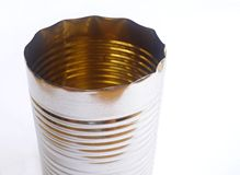 Empty tin can. An image of an empty open metal tin can with its top  cut off.  Horizontal format, taken on white background with copy space Stock Images