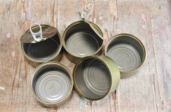 Empty tin can on board Stock Image