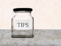 Empty tips jar on counter. No money. Royalty Free Stock Images