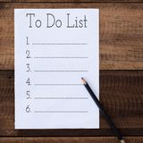 Empty to do list with pencil on wooden table stock image