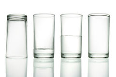 Empty To Full. Tall empty, half and full glass of water isolated on white with clipping path included Royalty Free Stock Image