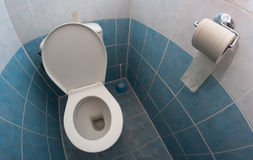 Empty toilet Stock Images