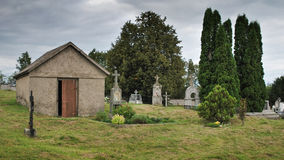 Empty tomb. Old cemetery in cloudy and rainy day royalty free stock images