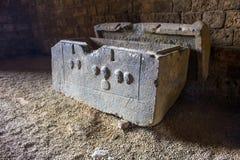 The empty tomb of ancient Phoenician sarcophagus. Tripoli, Lebanon. Tripoli, Lebanon - January 15, 2016: The empty tomb of ancient Phoenician sarcophagus royalty free stock photos