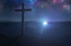Empty tomb and cross. A single cross with the empty tomb in the background Stock Images