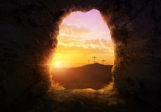 Empty tomb. With three crosses on a hill side Stock Image
