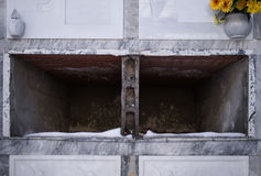 Empty tombs with snow - mortality concept Stock Image