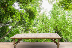 Empty top of bamboo wood table on Green leaves background. Royalty Free Stock Image