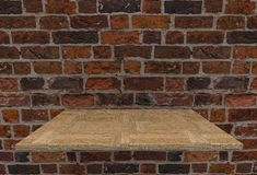 Empty top hard wood floor shelves and old english brick wall background Royalty Free Stock Photos