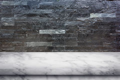 Empty top of marble table on black marble stone wall background. Royalty Free Stock Photos
