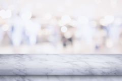 Empty top of marble table with blur shopping mall background. Royalty Free Stock Image