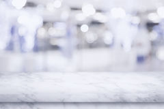 Empty top of marble table with blur shopping mall background. Stock Photos