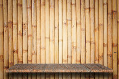 Empty top of natural stone shelves and bamboo wall background Stock Image