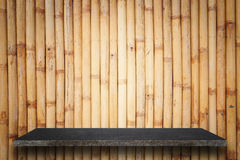 Empty top of natural stone shelves and bamboo wall background Royalty Free Stock Image