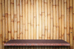 Empty top of natural stone shelves and bamboo wall background Royalty Free Stock Images