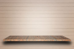 Empty top of natural stone shelves and wooden wall background royalty free stock photo