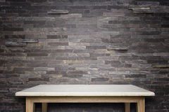 Empty top of natural stone table and stone wall background stock image