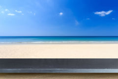 Empty top of natural stone table and view of tropical beach back Stock Photo