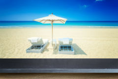 Empty top of natural stone table and view of tropical beach back Stock Images