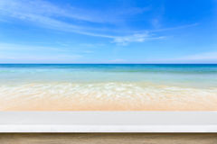 Empty top of natural stone table and view of tropical beach back Royalty Free Stock Photo