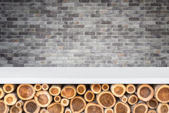 Empty top of stone table or counter with pile of wood log on sto Royalty Free Stock Photography