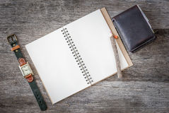 Empty top view of notebook on wooden background with retro style Stock Image