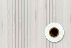Empty top view of wooden table and black coffee in white ceramic. Cup.For display of your products Stock Photos