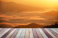 Empty top view of wooden table and view of sunset or sunrise. Royalty Free Stock Photography