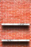 Empty top of white marble shelf with old brick wall. stock images