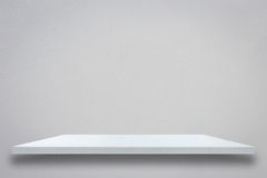 Empty top of white wooden shelf on grey cement wall Stock Photos