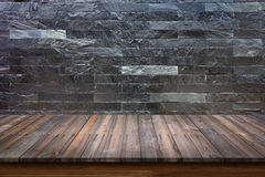 Empty top of wood table on black marble stone wall background. Royalty Free Stock Photos