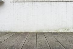Empty top wood table over grunge brick wall background. For Prod royalty free stock photography