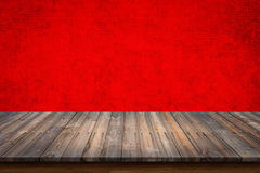 Empty top of wood table on red concrete wall background. Empty top of wood table with red concrete wall background. For display or montage your products royalty free stock photography