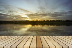 Empty top wooden decking and sunset moment at little lake background. Can use for product display Stock Photography