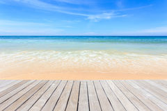 Empty top of wooden decking and view of tropical beach Stock Image