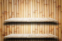 Empty top wooden shelves and bamboo wall background Stock Photo