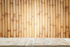 Empty top wooden shelves and bamboo wall background Stock Photography