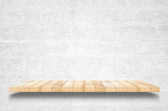 Empty top wooden shelves and concrete wall background.