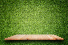 Empty top of wooden shelves and green pattern wall background Royalty Free Stock Photos