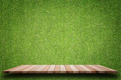 Empty top of wooden shelves and green pattern wall background Stock Images