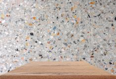 Empty top wooden shelves and polished stone wall background