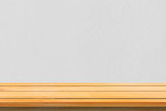Empty top wooden shelves and stone wall background. Perspective brown wood shelves over stone wall background.