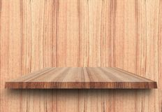 Empty top wooden shelves and woody wall background. For product display with copy space. Add text stock photography