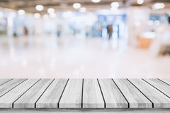 Empty top of wooden table with blur shopping mall background. Stock Photo